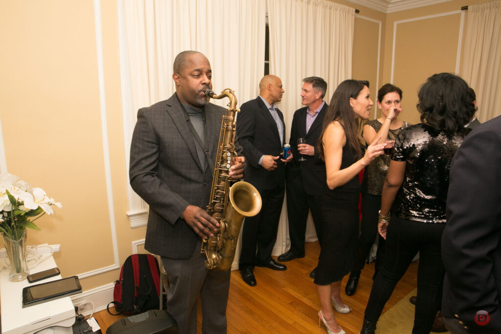 Todd Ledbetter on solo sax at event