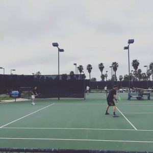 If you've ever seen adult doubles action, this was very similar to that, except these kids could move at Barnes Tennis Center (San Diego, Ca) - USTA SCTA TOC