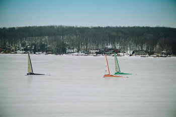 Ice boats racing on the lake.