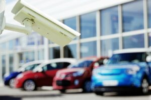 A picture of a car lot with a security camera