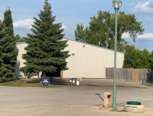 Golf course maintenance building with golf cart storage internet access