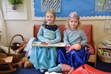 Two girls wearing crowns