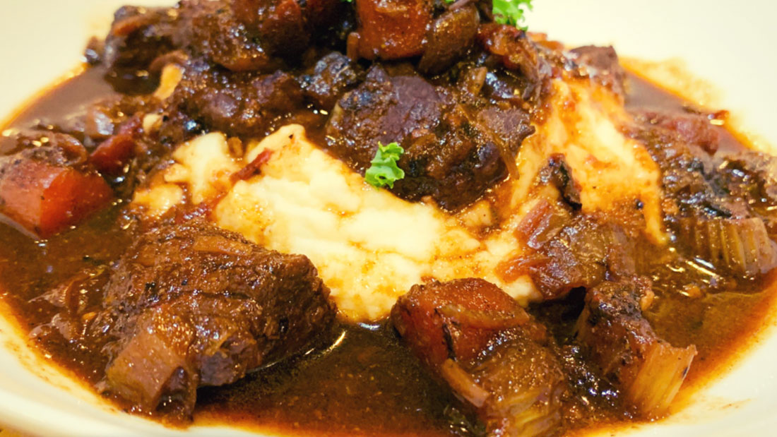 closeup of hearty beef stew with mashed potatoes