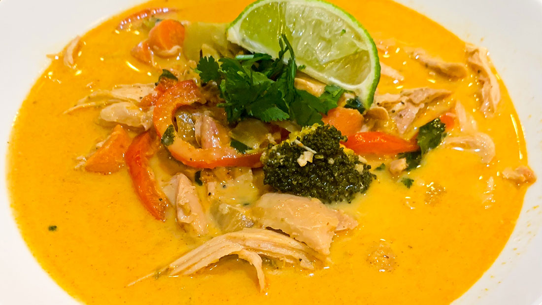 a bowl of coconut curry chicken soup