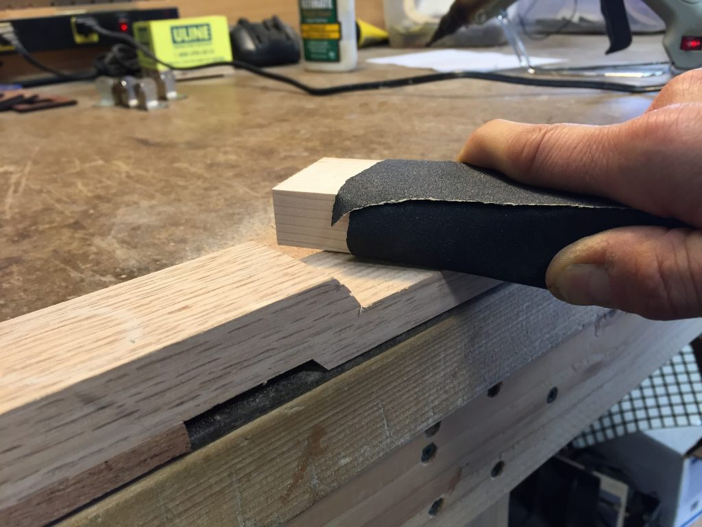 21 Sand straight headstock with rough grit sandpaper