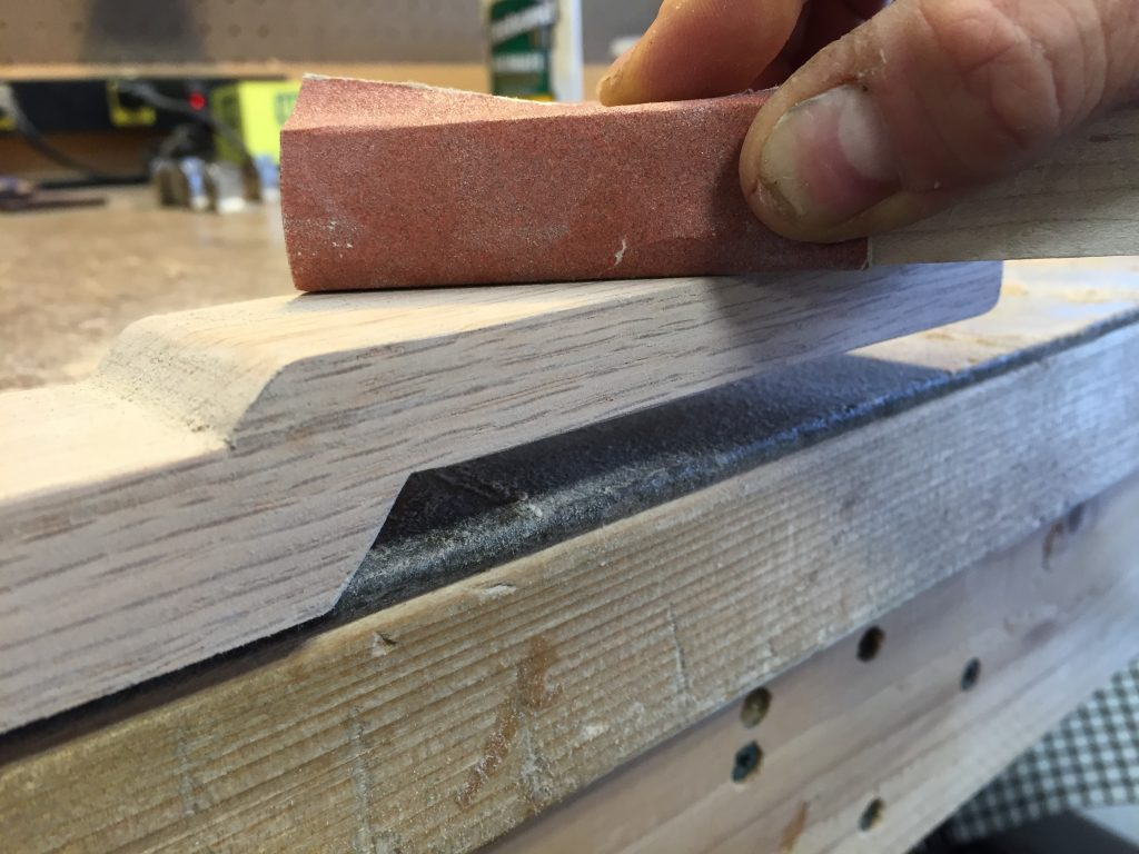 22 Sand straight headstock with fine grit sandpaper