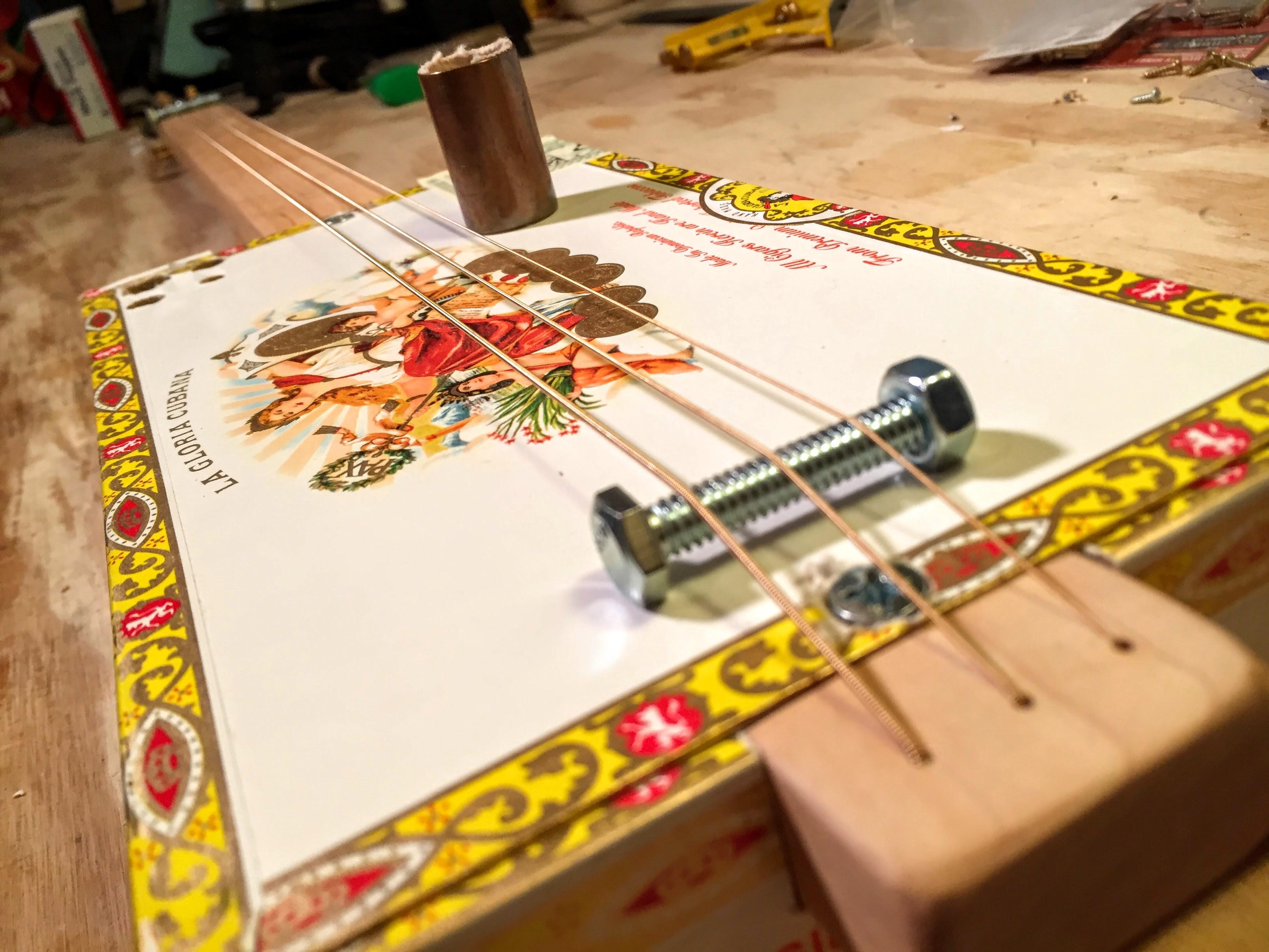 simple 3 string cigar box guitar