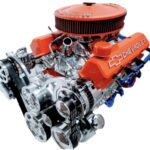 #6 350 375 HP orange valve covers and air cleaner, polished alternator, P/S pump, AC and polished intake