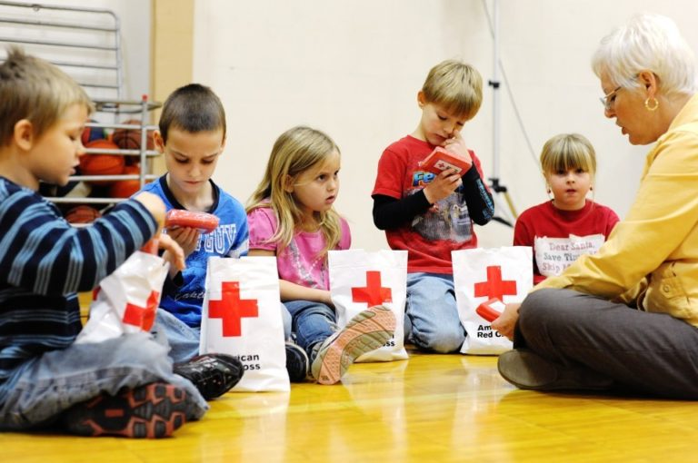 Children learning about first aid