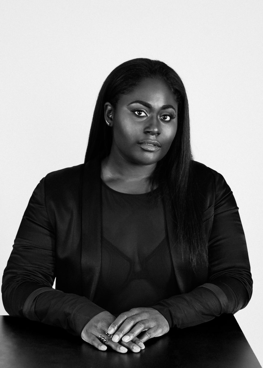 Danielle Brooks wearing a silk H&M blazer for MONROWE Magazine. Black and white photography by Lucas Cristino.