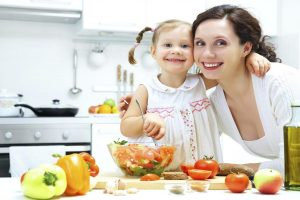 mom teaches daughter to cook