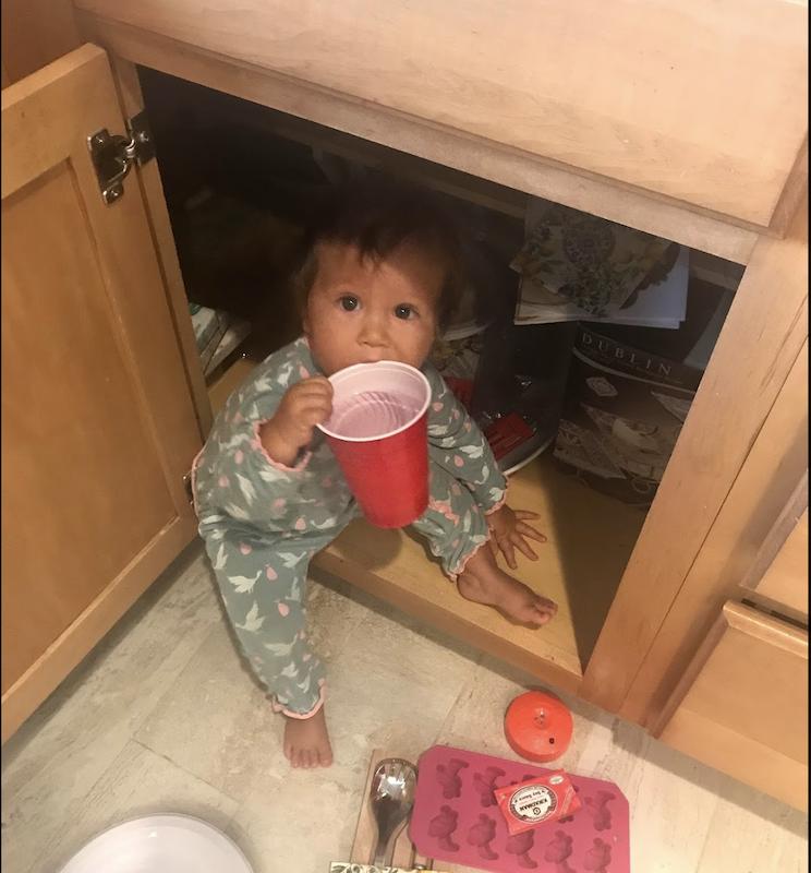 baby in cupboard