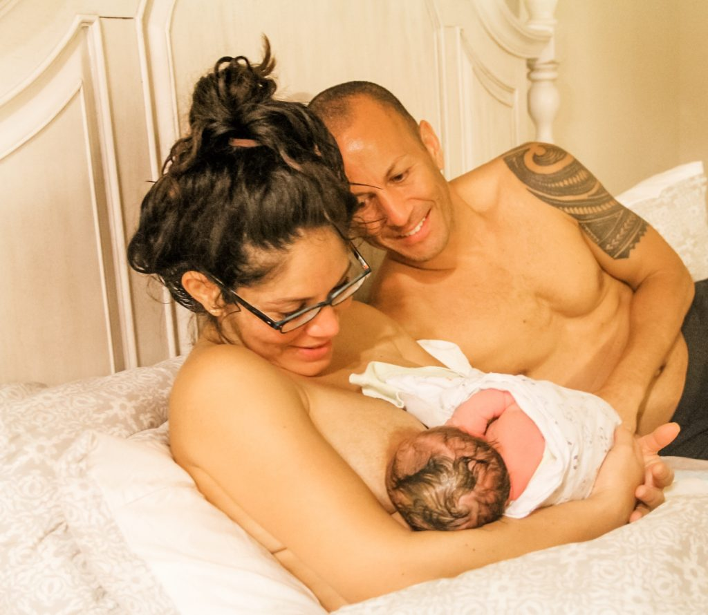 parents and newborn following a home birth