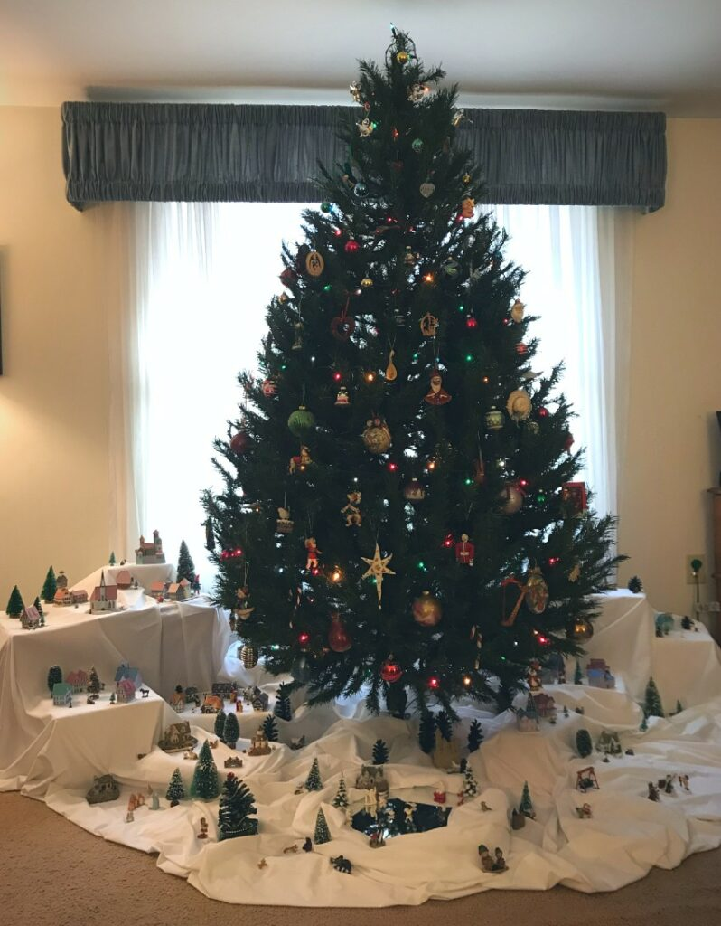 Christmas tree with Christmas villages beneath