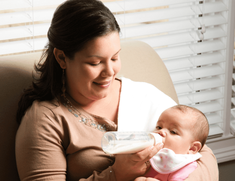 Mother and baby practicing paced bottle feeding