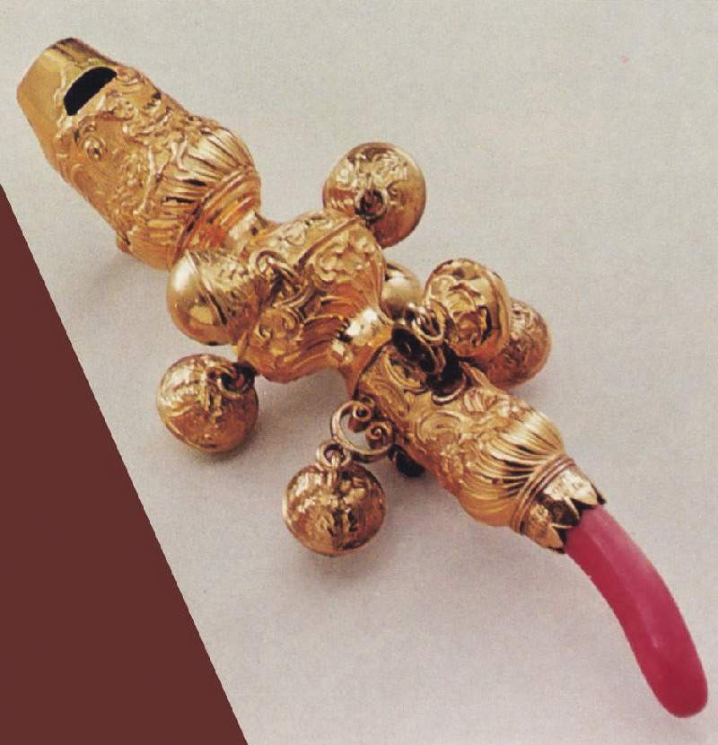 ancient pacifier made of gold and coral