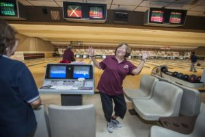 Pauline Fujino, 79, of Santa Ana, a member of the Nikkei Seniors bowling group, does a little dance following her strike early one morning at the Linbrook Bowling Center in Anaheim. MARK RIGHTMIRE, THE OC REGISTER