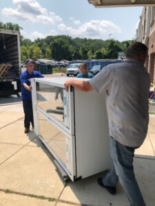 picture of new refrigerators being delivered to Baltimore police districts