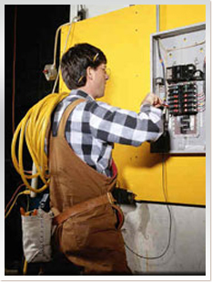 Picture of an electrician working in an electrical panel