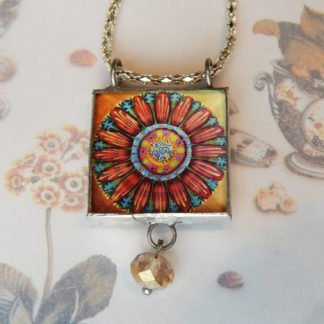 Danasimson.com front Looking glass double-sided glass pendent pop-art flower. Beveled glass with a bead detail.