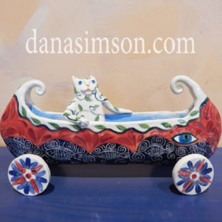 Danasimson.com Cat in canoe on wheels sculpture.