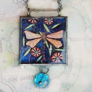 danasimson.com Handcrafted double sided beveled glass pendents with bead detail. dragonfly image.