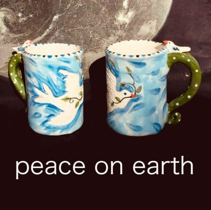 two mugs with peace dove