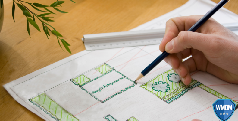 Landscaper drawing a professional landscaping plan.
