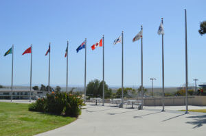 Different Country flags wave high outside the Olympic Training Center Visitor Center near the archery range