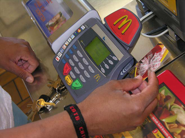 U.S. Credit Card Defaults Fall to 18-Month Low