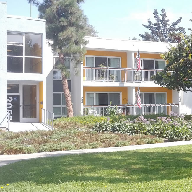 Exterior view of apartment building 3050 at American Gold Star Manor with apartments 328, 330, 340, and 342 visible.
