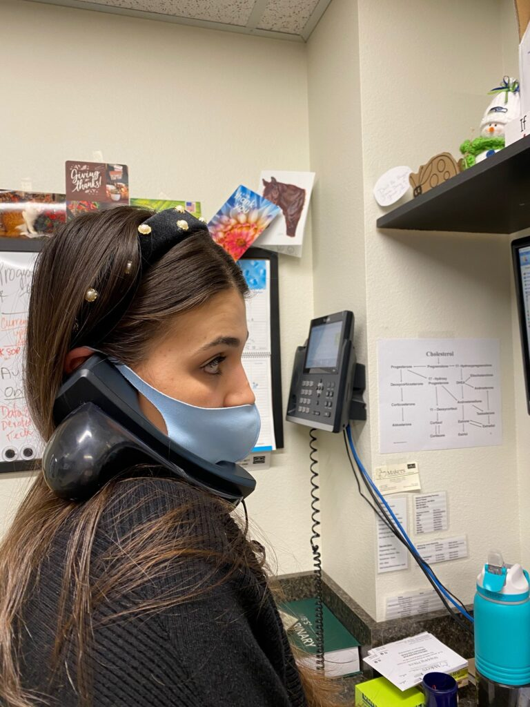 pharmacist intern Sydney speaking with a provider learning more about compounded formulas via phone