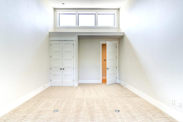 Natural light bedroom view of Doriot Construction's 2019 Mid Century Modern Build in Felida, WA