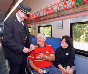 SAM Shortline passengers and conductor
