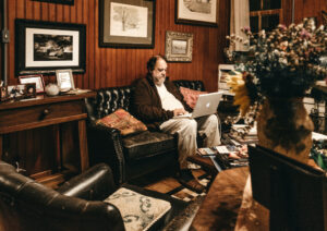 man on couch with computer