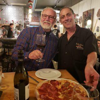 Bob serving pizza