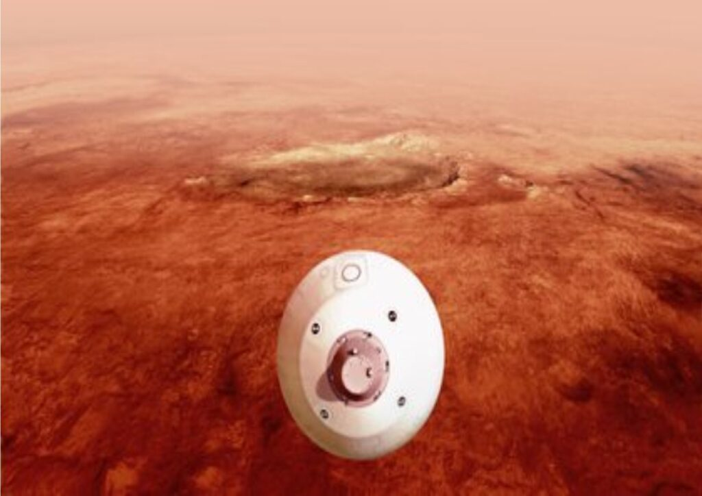 """Fotografía de la NASA donde aparece una ilustración del """"aeroshell"""" que contiene el rover Perseverance mientras hira pra para un aterrizaje seguro sobre la superficie de Marte."""