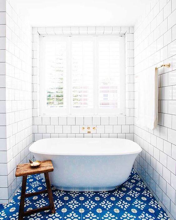 Bright blue bathroom tiles perk up a floor   Girlfriend is Better