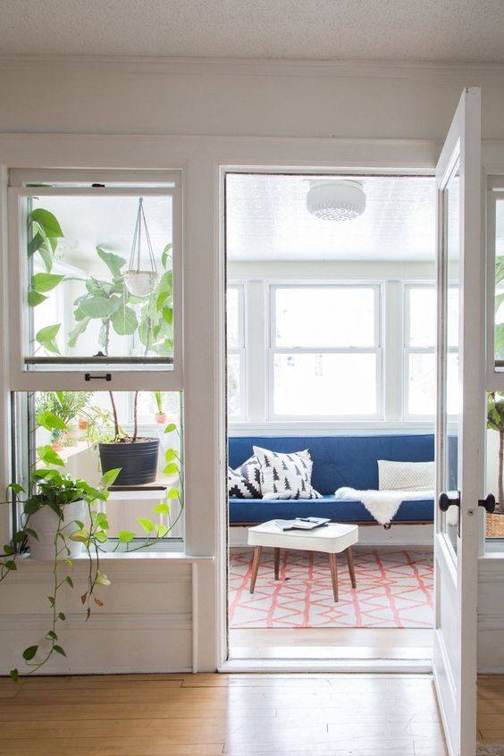 Turn a covered porch into a sunroom   candinavian, Midwestern Cabin mid-century modern   Girlfriend is Better
