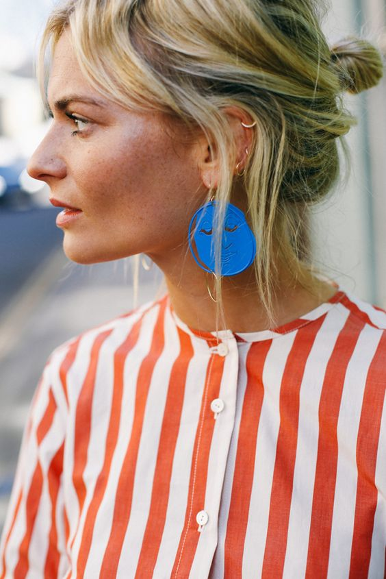 Statement earring and bold striped blouse in yellow and orange for Spring | Girlfriend is Better