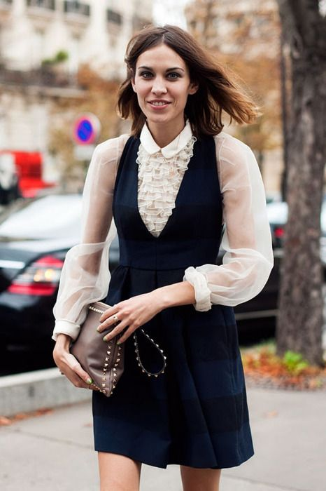 Alexa Chung in a ruffled tuxedo blouse and dark pinafore dress | Pinafores + Overalls | Girlfriend is Better