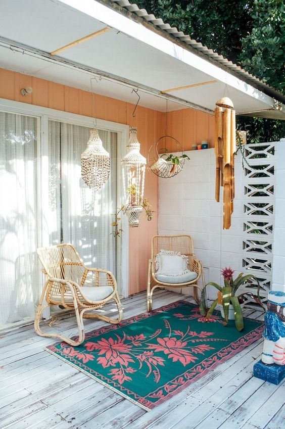 Surf shack patio with shell chandeliers and bamboo wind chimes   Girlfriend is Better