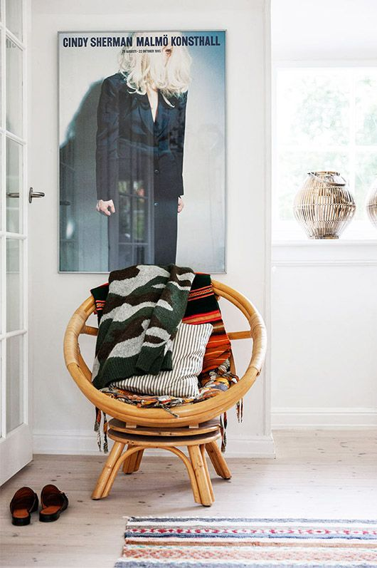Round bamboo chair in a bright entryway   Girlfriend is Better