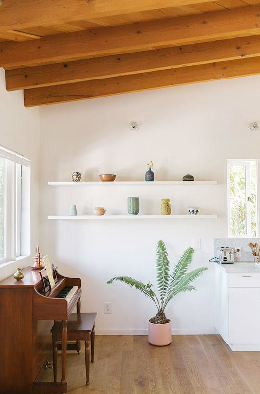 Create a nook with open shelving as a gallery wall | Girlfriend is Better