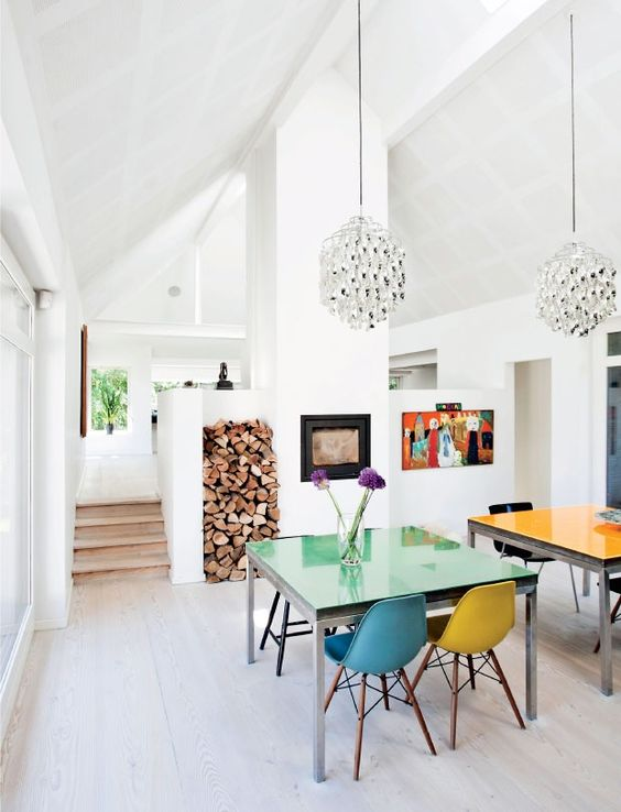 All-white modern kitchen with rainbow dining chairs   Girlfriend is Better