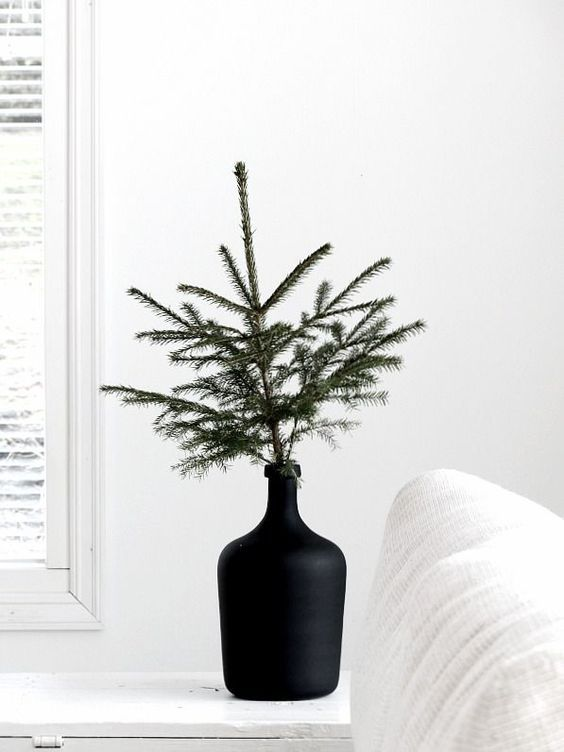 Christmas tree branch in contemporary vase   Hygge decor   Girlfriend is Better