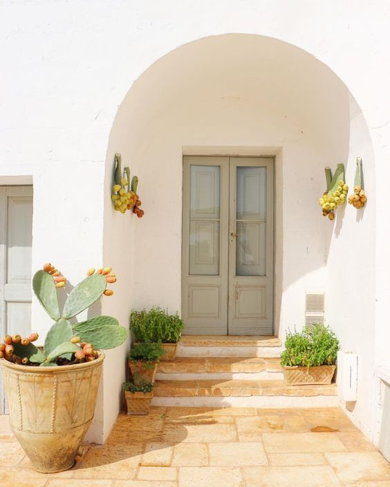 Earth element Feng Shui | Stucco entryway with stone steps and prickly pears | Girlfriend is Better
