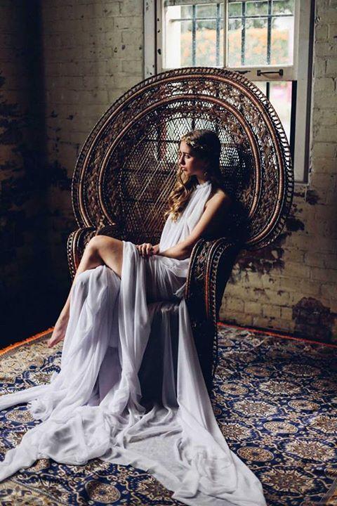 Bohemian bride in peacock chair vintage Persian rug | Girlfriend is Better