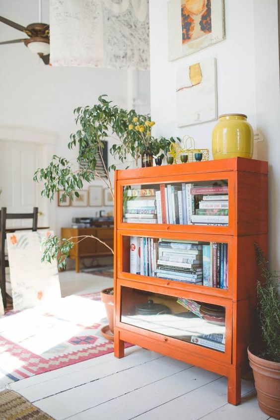 Gemini astrology home decor   Upcycled orange glass case bookshelf   Girlfriend is Better