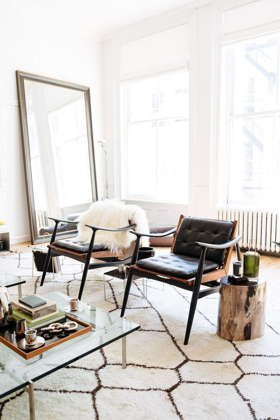 Gemini astrology home decor guide   Black leather mid-century modern chairs   Girlfriend is Better